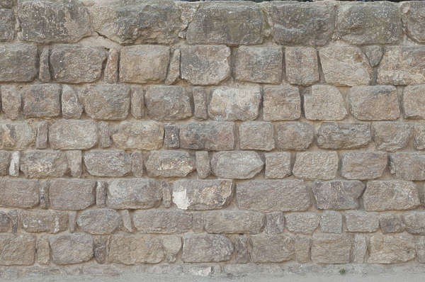 old wall bricks irregular stones rounded