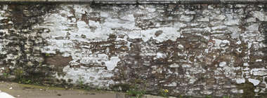 brick medieval plastered messy old weathered UK