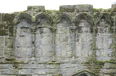 brick medieval ornate ornament arches mossy cathedral UK