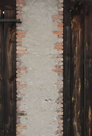 plaster bare barn bricks