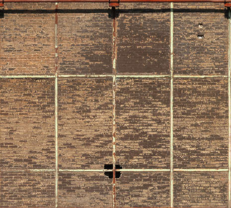 brick small brown dirty old reinforced facade building