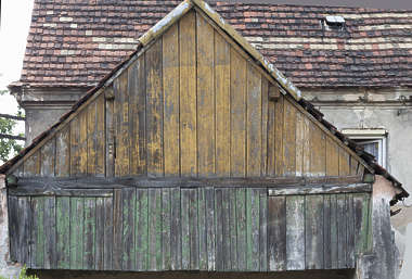 wood planks old painted worn weathered building derelict facade