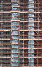 buildings highrise under construction scaffolding