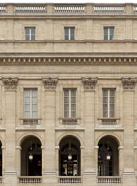 building historical facade france columns ornate arches neoclassical