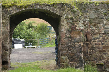 brick medieval arch entrance old mossy UK