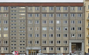 building facade apartment residential tenement block tall