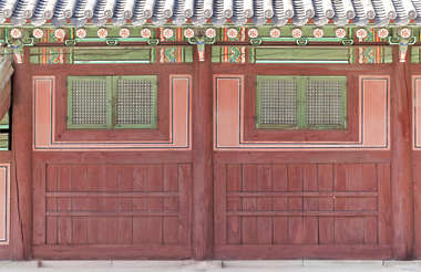 south korea temple buddhist ornate facade building planks plank wood old