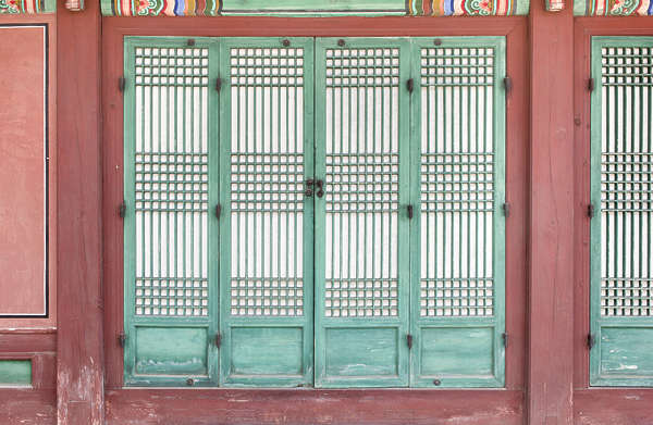 south korea temple buddhist ornate facade building door wood old