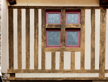 tudor plaster stucco wall building facade medieval old wood window