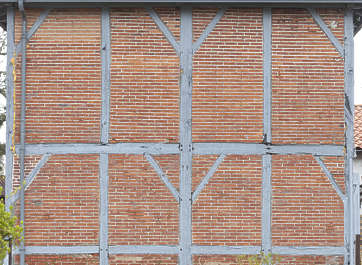 tudor facade building wood brick small bricks beams spain