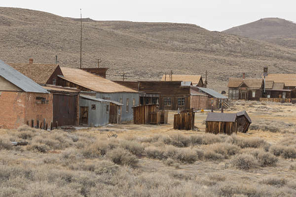 USA Bodie reference ghost town wild west mining village old abandoned structures wood desert united states barn