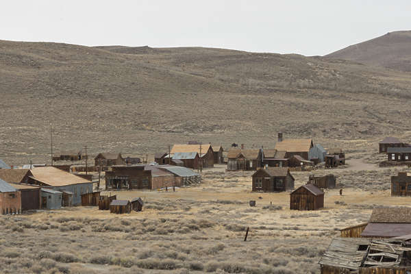 USA Bodie reference ghost town wild west mining village old abandoned structures wood desert united states panorama