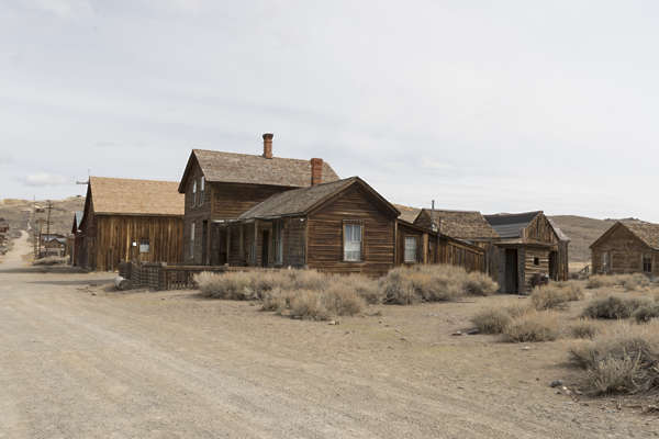 USA Bodie reference ghost town wild west mining village old abandoned structures wood desert united states