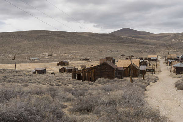 reference ghost town wild west mining village old abandoned structures wood desert united states panorama