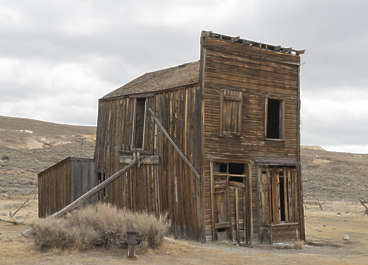 USA Bodie ghosttown ghost town old western goldrush desert arid building wooden house shop storefront