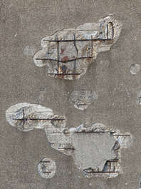 plaster damaged concrete rebar old broken seam