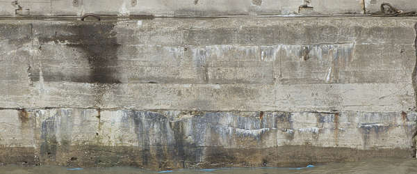 concrete bunker bare dirty leaking dock wall harbor harbour