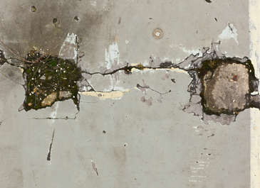 concrete floor damaged hole