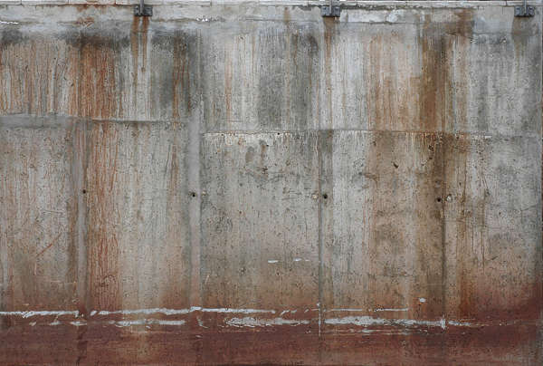 concrete leaking rust bare