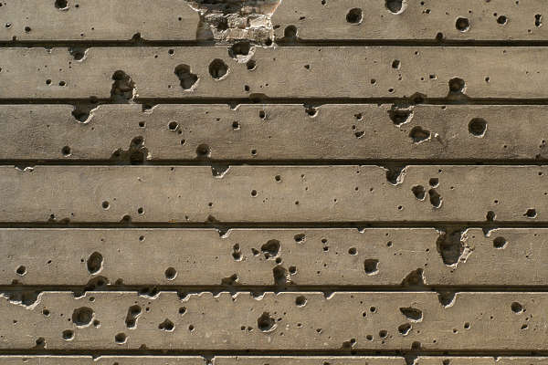 concrete bare damaged bullet holes WWII