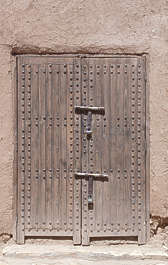 north africa arabia arabian morocco wooden door double studded old dirty weathered