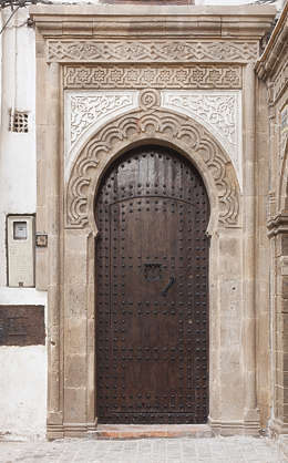 north africa arabia arabian morocco door double old wooden weathered arch archway studded studs ornate