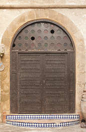 north africa arabia arabian morocco door double old wooden weathered arch archway ornate