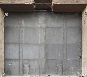 door huge armored bunker submarine WWII base metal plates plated shelter