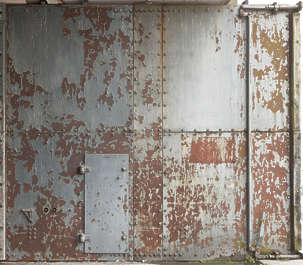 door huge armored bunker submarine WWII base metal plates plated shelter rusted old