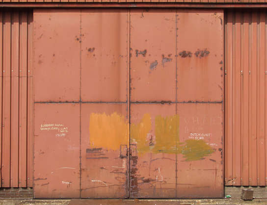 door metal rust painted scratches warehouse