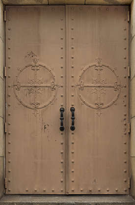 metal door double ornate rivets
