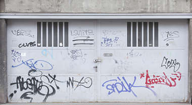 door double metal industrial garage gate graffiti tags