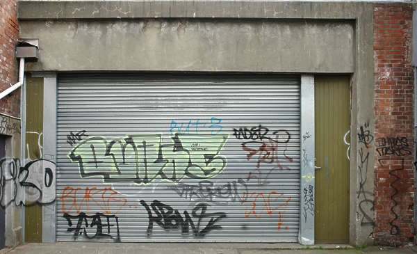 door garage metal rollup graffiti