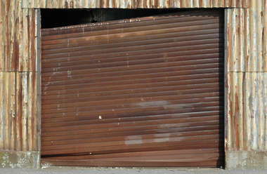 door metal rollup rust rusted garage broken
