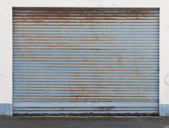 door big rollup painted rust rusted metal garage
