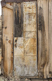 USA Bodie ghosttown ghost town old western goldrush desert arid door metal single makeshift rusted