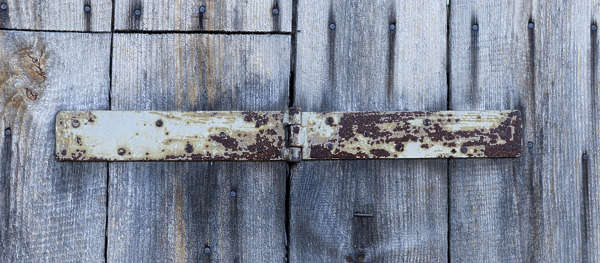 wood door old shed planks hinge lock rusted barn