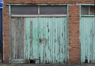 door double wooden painted old weathered worn garage UK