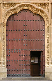 door wood planks ornate arch church studded armored