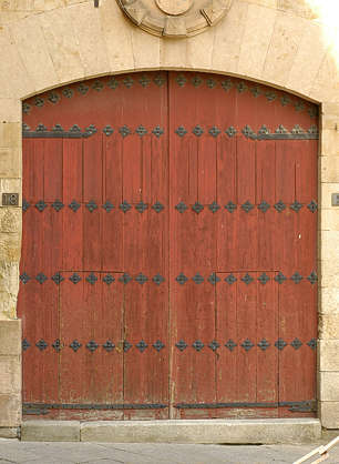 door wood planks ornate church studded armored