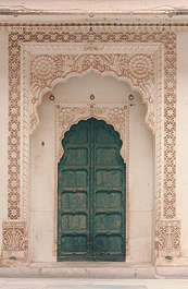 india door ornate wood temple arch stone