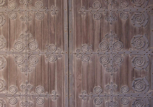 wood planks old ornaments metal door hinges closeup
