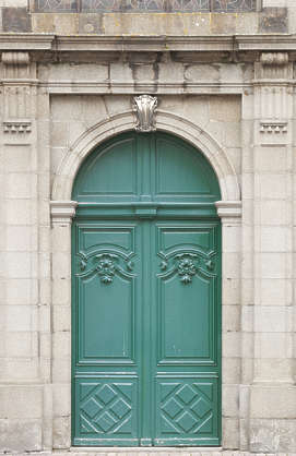door wood double ornate arch columns church panelled panels