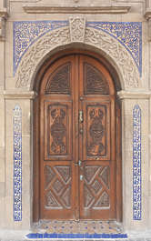 north africa arabia arabian morocco door double old painted wooden weathered arch archway ornate