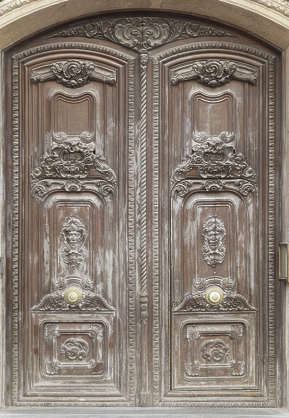 door double wooden ornate old dirty spain