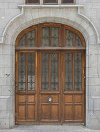 door old ornate panelled panel wood arch arched