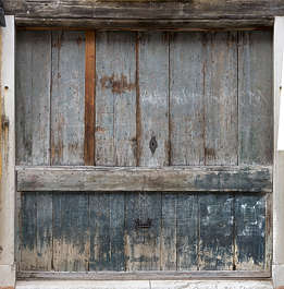 venice italy wood painted worn weathered planks door shop medieval