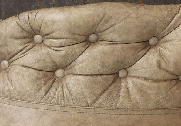 leather brown couch wrinkles folds