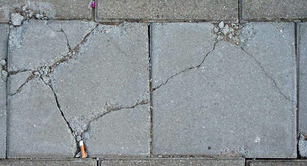 pavement sidewalk tile cracked broken damaged