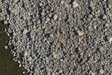 pebbles riverbed river bed gravel aerial floor ground cobble
